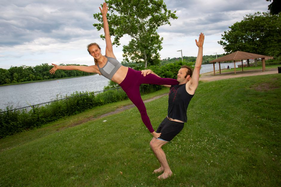 Christina Boyd and Sasha Krushnic demonstrate Acro Yoga along the river in Middletown June 5, 2018. | Richie Rathsack, Record-Journal