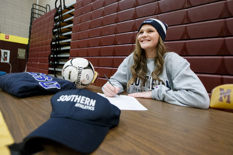 In a ceremony Tuesday at Sheehan High School, Kelsey Burr signs her National Letter of Intent to play soccer and study elementary education at Southern Connecticut State University. Justin Weekes, Special to the Record-Journal
