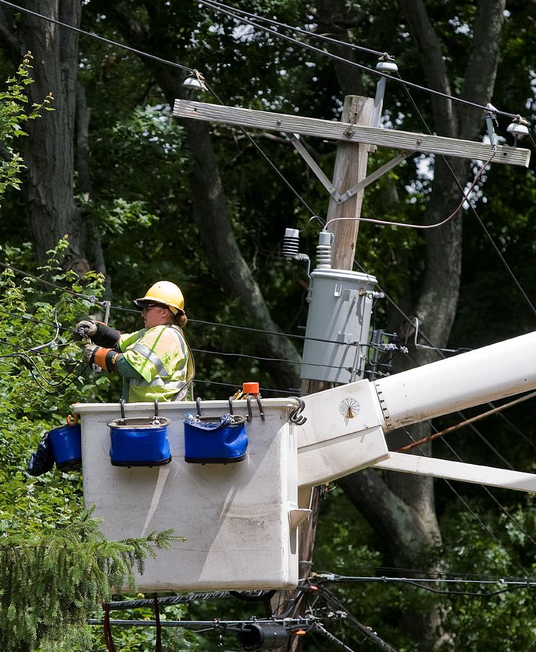 A worker for United Illuminating works on a line on Hartford Turnpike in North Haven, Wednesday, June 24, 2015. | Dave Zajac / Record-Journal