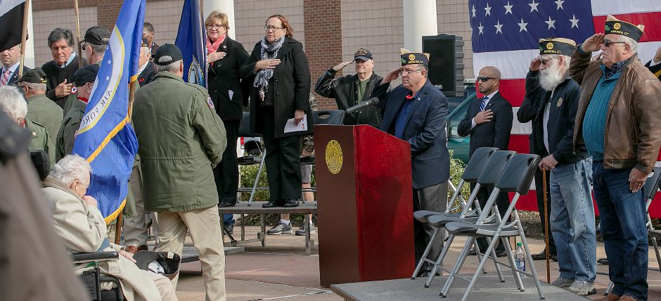 Veterans salute during Veteran