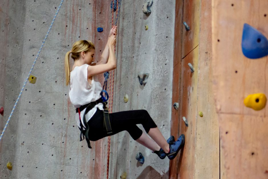 Ashley Kus, Record-Journal digital content producer, repels down the wall after rock climbing at Prime Climb Aug. 20, 2018. | Richie Rathsack, Record-Journal