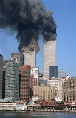 **  FILE **The south tower begins to collapse as smoke billows from both towers of the World Trade Center, in New York, in this Sept. 11, 2001, file photo. In one of the most horrifying attacks ever against the United States, terrorists crashed two airliners into the World Trade Center in a deadly series of blows that brought down the twin 110-story towers. (AP Photo/Jim Collins/FILE) ** zu unserem Korr **