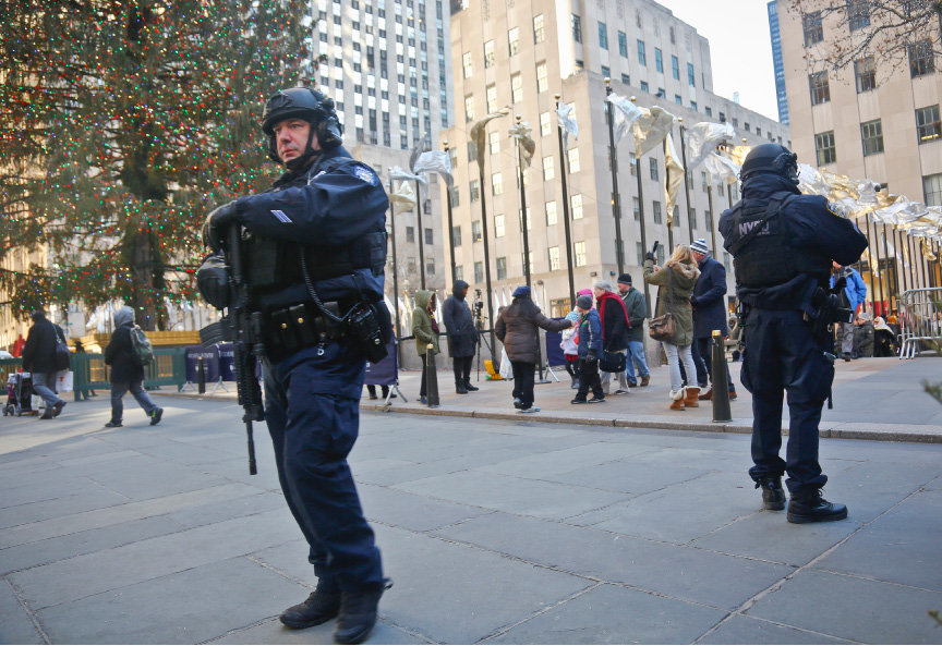 New York City Police patrol near the Christmas tree at Rockefeller Center in New York on Tuesday. New York City Mayor Bill de Blasio says police are reinforcing various Christmas market locations around the city in the wake of the attack in Berlin, Germany that killed 12 people and wounded nearly 50 on Monday. | Associated Press