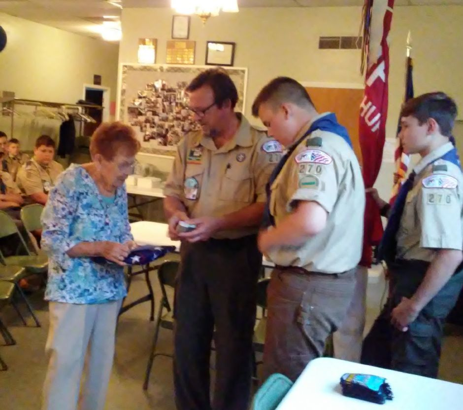 The Boy Scouts of Durham presented a flag flown in Normandy to Stacia Bogdan, the sister of a fallen solider, on May 28. | Photo courtesy Joseph Smith