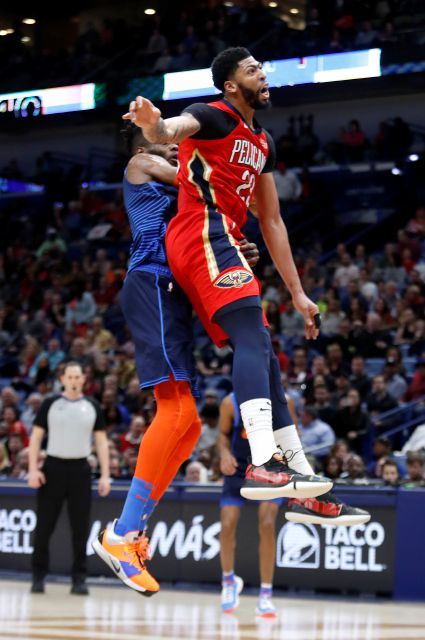 New Orleans Pelicans forward Anthony Davis (23) collides with Oklahoma City Thunder forward Nerlens Noel (3) after attempting to block a shot at the end of the first half of an NBA basketball game in New Orleans, Thursday, Feb. 14, 2019. Davis kept his left arm still as he walked to the locker room shortly after fouling Noel on an attempted shot block with his left hand. When the second half began, the Pelicans announced that Davis was out of the remainder of the game with a left...