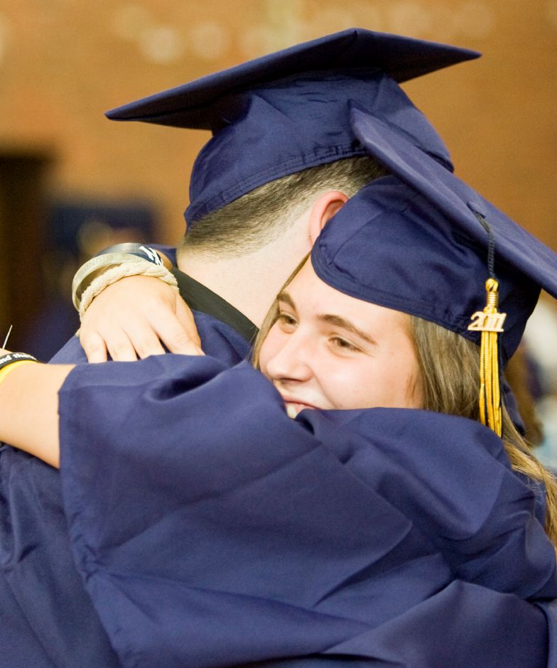 Jamie Petit, 17, hugs Christopher Crespo, 18, as the graduates gather before the ceremony in the gym of Platt High School Monday evening in Meriden, June 20, 2011. (Christopher Zajac / Record-Journal)