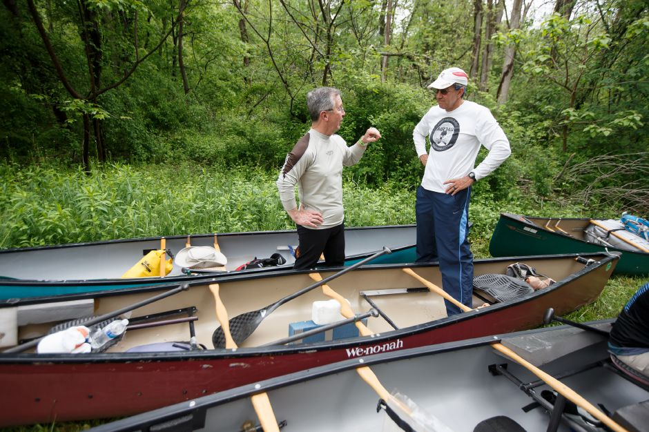 Tom Lewis of Rocky Hill left talks with Del Cummings of Meriden Sunday during the 38th annual Down River Classic on the Quinnipiac River in Meriden May 20, 2018 | Justin Weekes / Special to the Record-Journal