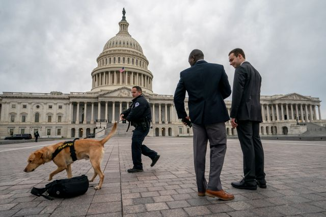 A police officer and K-9 do a routine security check at the Capitol as the partial government shutdown lurches into a third week with President Donald Trump standing firm in his border wall funding demands, in Washington, Monday, Jan. 7, 2019. After no weekend breakthrough to end a prolonged shutdown, newly empowered House Democrats are planning to step up pressure on Trump and Republican lawmakers to reopen the government. (AP Photo/J. Scott Applewhite)