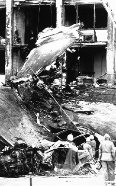 Military personnel remove the wing of an Air Force Corsair from the rubble of the Ramada Inn, Wednesday, Oct. 21, 1987, Indianapolis, In. Workers removed the wing from roof of the one-story carport where it came to rest after crashing into the hotel Tuesday after the engine, bottom left, lost power. (AP Photo/Michael Conroy)