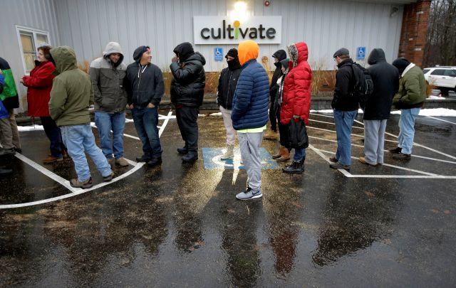 Customers wait outside the Cultivate cannabis dispensary to purchase recreational marijuana on the first day of legal sales, Tuesday, Nov. 20, 2018, in Leicester, Mass. Cultivate is one of the first two shops permitted to sell recreational marijuana in the eastern United States, opening more than two years after Massachusetts voters approved it in 2016. (AP Photo/Steven Senne)