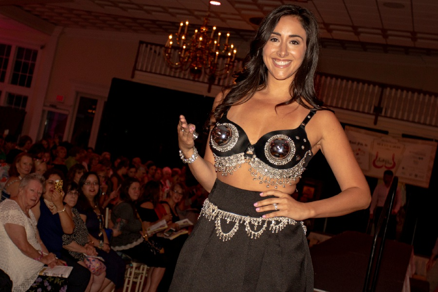 "Morgan Napier wears ""Ring My Bell"" on the runway during the Art Bra 2018 Runway Show and Auction Aug. 9, 2018 at the Aqua Turf in Southington. 