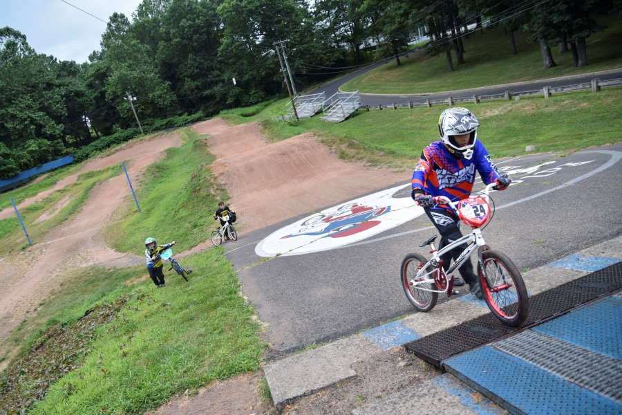 Riders practice on the Falcon BMX track after a race on Thursday, July 11, 2019 in Meriden. | Bailey Wright, Record-Journal