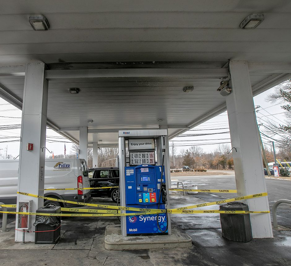 Caution tape surrounds gas pumps after a postal vehicle caught fire at the Mobil Station at 276 Washington Ave., in North Haven, Wed., Feb. 27, 2019. Dave Zajac, Record-Journal