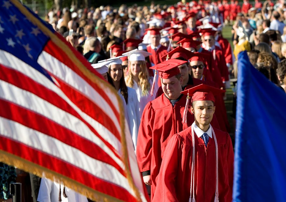 Graduate Robert McMullin eyes diplomas stacked on stage during the processional march into graduation ceremonies at Cheshire High School, Friday, June 10, 2016. | Dave Zajac, Record-Journal