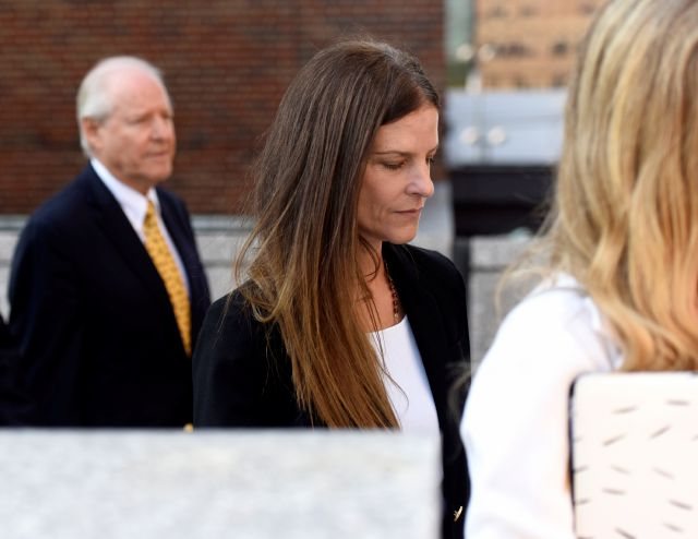 Michelle C. Troconis, 44, exits after appearing in court in relation to her charges of tampering with or fabricating physical evidence and first-degree hindering prosecution, to which she has pleaded not guilty, at Connecticut Superior Court in Stamford, Conn. Monday, Aug. 19, 2019. The charges stem from video surveillance footage that police said shows two people resembling Troconis and Fotis Dulos making more than 30 stops in a four-mile stretch of Hartford the night of the...