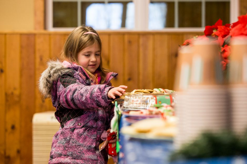 Mia Carpenter 5 of Southington picks out a cookie Saturday during Santa at Sloper hosted by the Mill Foundation at the YMCA