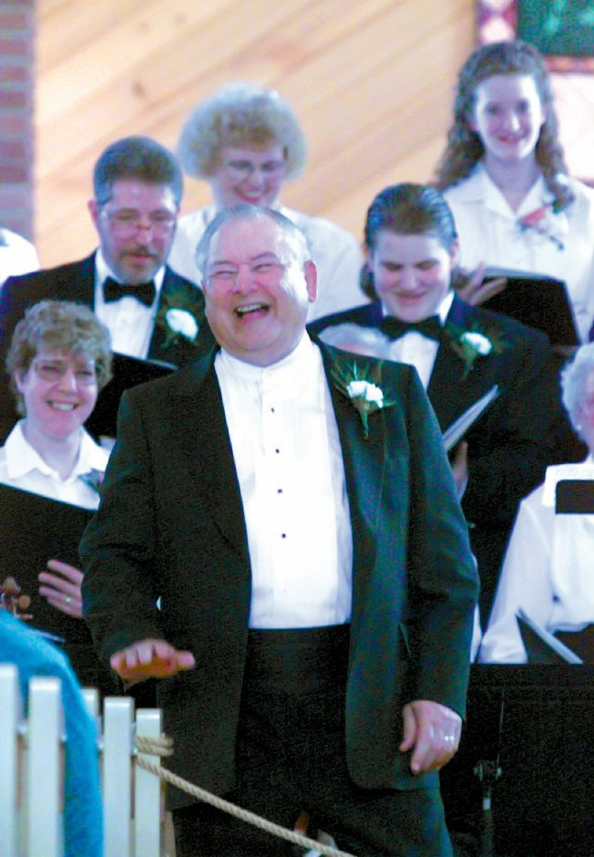 RJ file photo - Joseph W. Geyer, conductor of the Southington Festival Chorale, shares a laugh with the audience during a performance May 2, 1999.