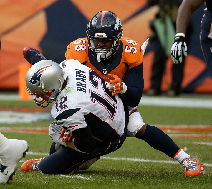 Patriots quarterback Tom Brady is sacked by the Broncos