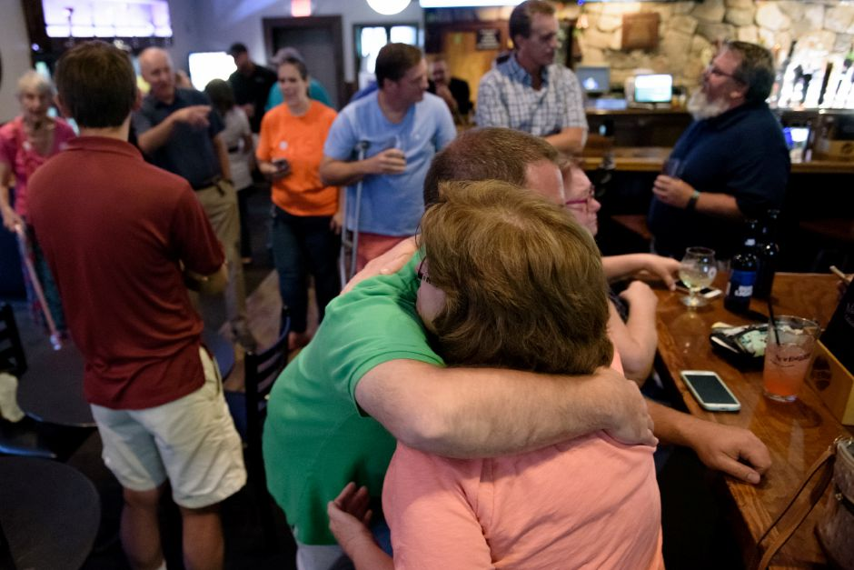 Meriden, CT - 07/18/2018: Michael Carabetta hugs Tina Manley celebrating the results in Maloney