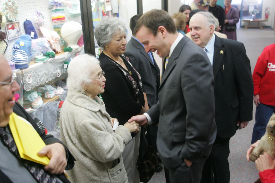 Congressman Chris Murphy, center, is followed by Matthew C. Dominello, right, as Murphy shakes hands with Louise Forcier, of Meriden, as Murphy makes greets people on his way in the Meriden Senior Center Monday morning March 19, 2007. Later during a ceremony, Murphy cut a ribbon on an office that is given to congressional office holders, inside the senior center. Chris Angileri/Record-Journal.