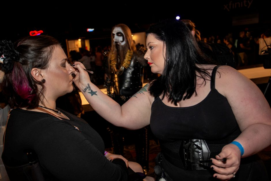 Makeup artist Rachel King, surrounded by her subjects, works on another at the RAW Artist Connect showcase at the Oakdale Theatre July 18, 2018. | Richie Rathsack, Record-Journal