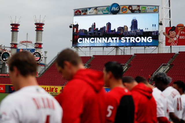 A moment of silence is observed for the three dead and others wound in a shooting downtown, at Great American Ball Park before a baseball game between the Cincinnati Reds and the San Diego Padres, Thursday, Sept. 6, 2018, in Cincinnati. (AP Photo/John Minchillo)