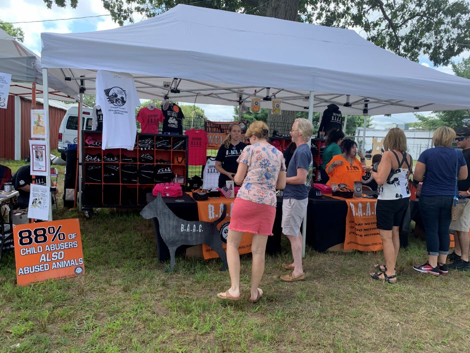 Volunteers from BAAC set up a booth where they sold t-shirts and posted facts about abused and neglected animals. Photo by Everett Bishop, North Haven Citizen.
