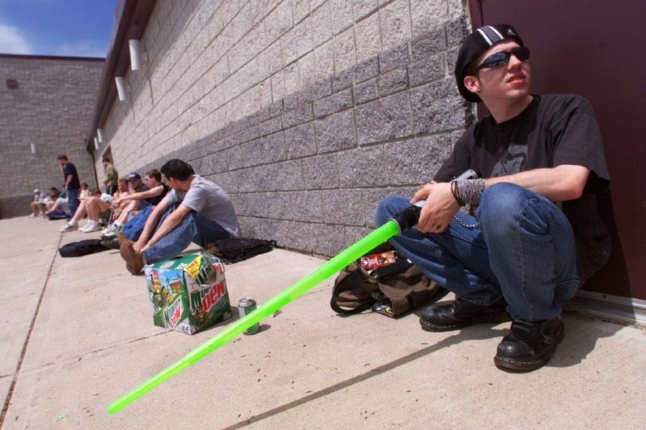 "RJ file photo - Michael Madzek, 24, of Wolcott, waits in line for tickets to ""Star Wars: Episode I -The Phantom Menace"" at Showcase Cinemas in Southington May 12, 1999."