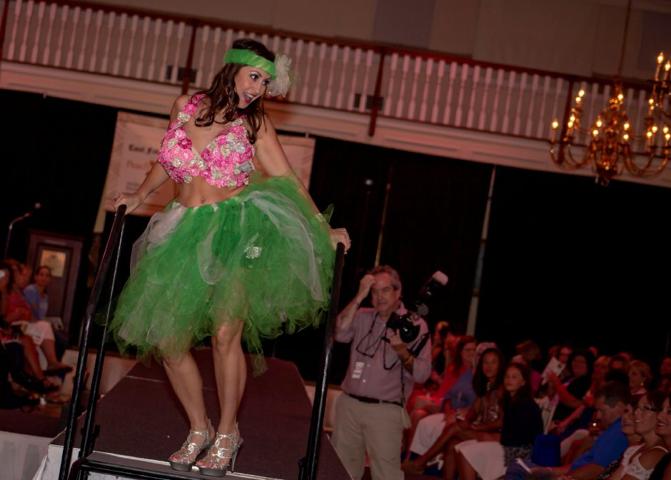 "Cara Cama works the runway wearing ""Sewing Seeds of Hope"" during the Art Bra 2018 Runway Show and Auction Aug. 9, 2018 at the Aqua Turf in Southington. 