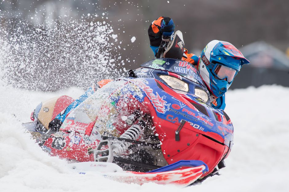 Wyatt Hoffman of New Berlin NY pilots his Polaris 600cc in the sport stock class Sunday during the debut of East Coast Snocross race at Mount Southington in Plansville Mar. 19, 2017 | Justin Weekes / For the Record-Journal
