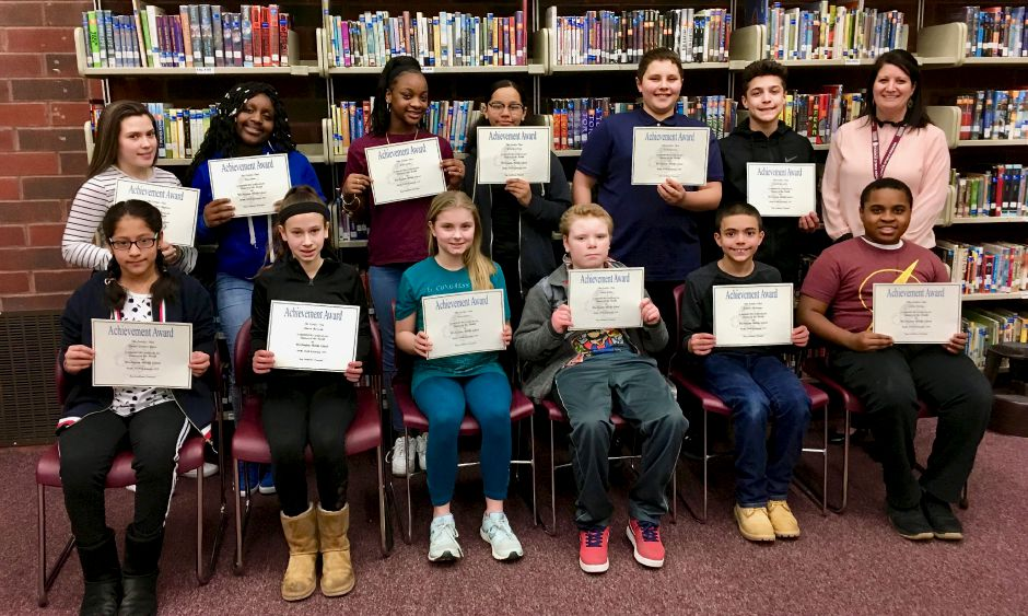 Front row: Karina Guartan Yauri, Christie Harrison, Clara Fisher, Shane Kelly, Nicholas Rodriguez, and Julius Dailey; back row: Dariany Gonzalez Chaparro, Ciara Bone, Jayla Smith, Yonaely Lebron,  Jaedan Curcio and Joziah Gonzalez with Vice Principal Jessica Shoerda; not pictured: Kristina Madden.