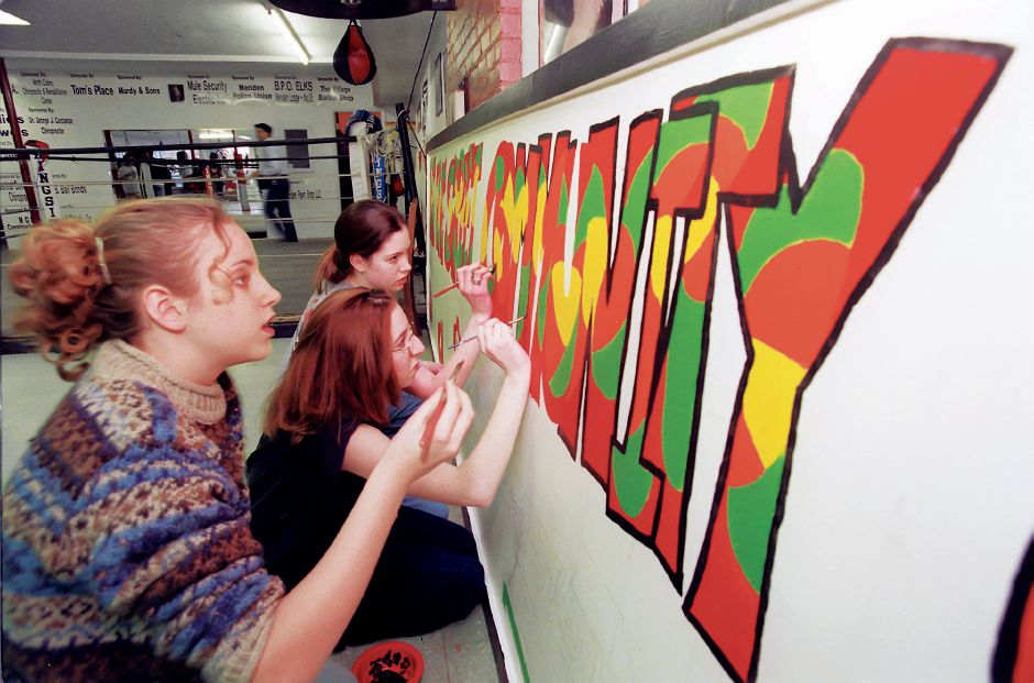 RJ file photo - Area students work on a sign they designed for the Beat the Street Community Center, March 1999. The new center is the former Silver City Boxing Club, which has expanded its mission of serving Meriden
