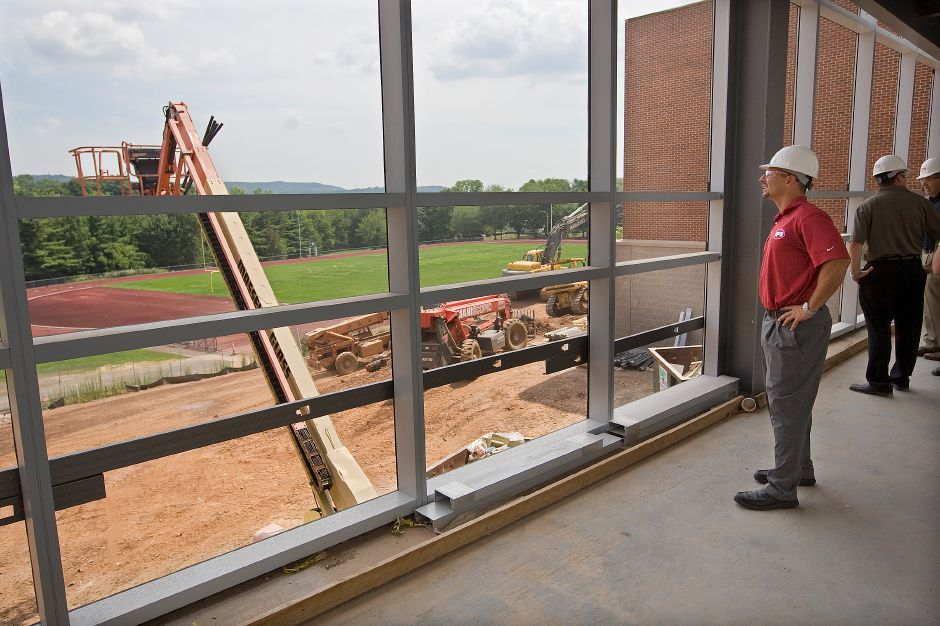 School Superintendent Mark D. Benigni checks out the view from the new connector bridge while touring Maloney High School, Wednesday, July 29, 2015. The school is in the midst of a $107.5 million reconstruction and renovation project. | Dave Zajac / Record-Journal
