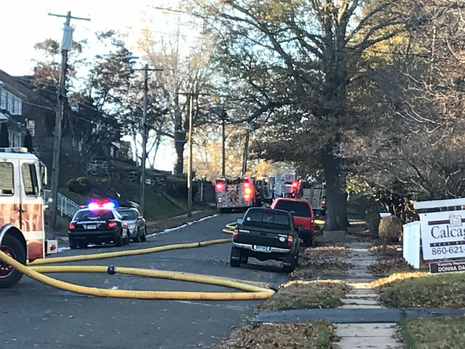 The Meriden fire marshal's office, Meriden police and state police are investigating a house fire on Carpenter Avenue on Thursday, Nov. 23, 2017. | Pete Paguaga, Record-Journal
