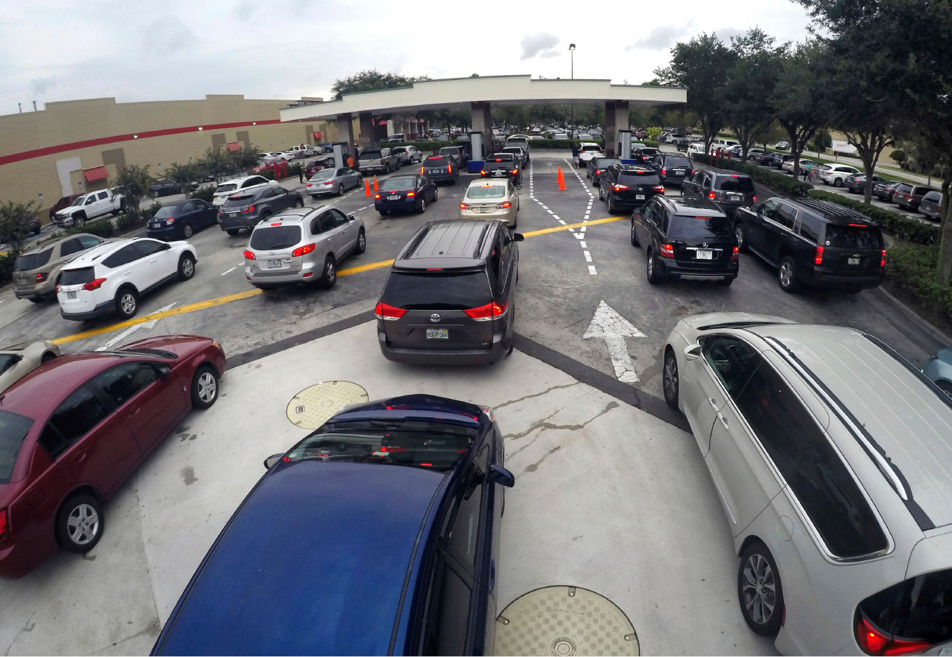 Drivers wait in line for gasoline   in Altamonte Springs, Fla., ahead of the anticipated arrival of Hurricane Irma, Wednesday, Sept. 6, 2017. Irma roared into the Caribbean with record force early Wednesday, its 185-mph winds shaking homes and flooding buildings on a chain of small islands along a path toward Puerto Rico, Cuba and Hispaniola and a possible direct hit on densely populated South Florida.  (Joe Burbank/Orlando Sentinel via AP)