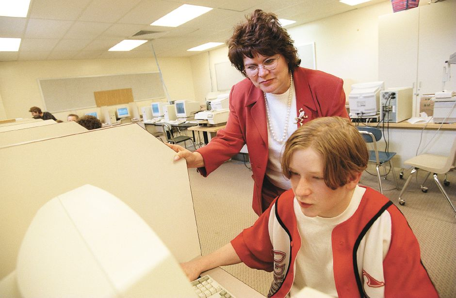 RJ file photo - Bonnie Lee Rabe works with a student at Johnston Middle School in Colchester, where she has been principal. Raby was chosen to run the new magnet school in Meriden, May 1999.
