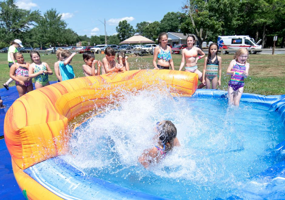Children cooled off ona water slide during the Plainville 150th celebration of its incorporation. The event, held at Norton Park on July 21, 2019, included music, food trucks and historic presentations. | Devin Leith-Yessian/Plainville Citizen