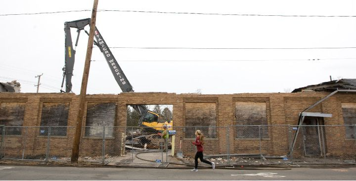 FILE PHOTO: A jogger passes two former Ideal Forging buildings currently being demolished on High St. in Southington, Tuesday, March 31, 2015. | Dave Zajac / Record-Journal