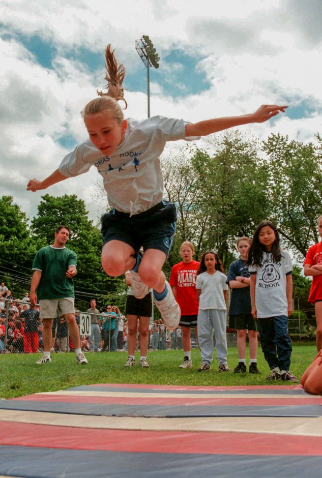 Shannon Gagnon, 11, from Thomas Hooker soars through the air to 1st place in the standing broad jump at the City Wide field day at Ceppa field in Meriden May 27, 1999.