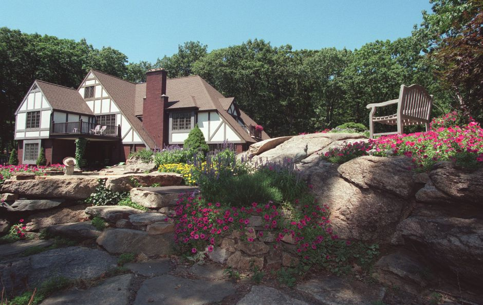The home of Linda Renaud has a large rock garden decorated with flowers and includes a hot tub, Aug. 1999.