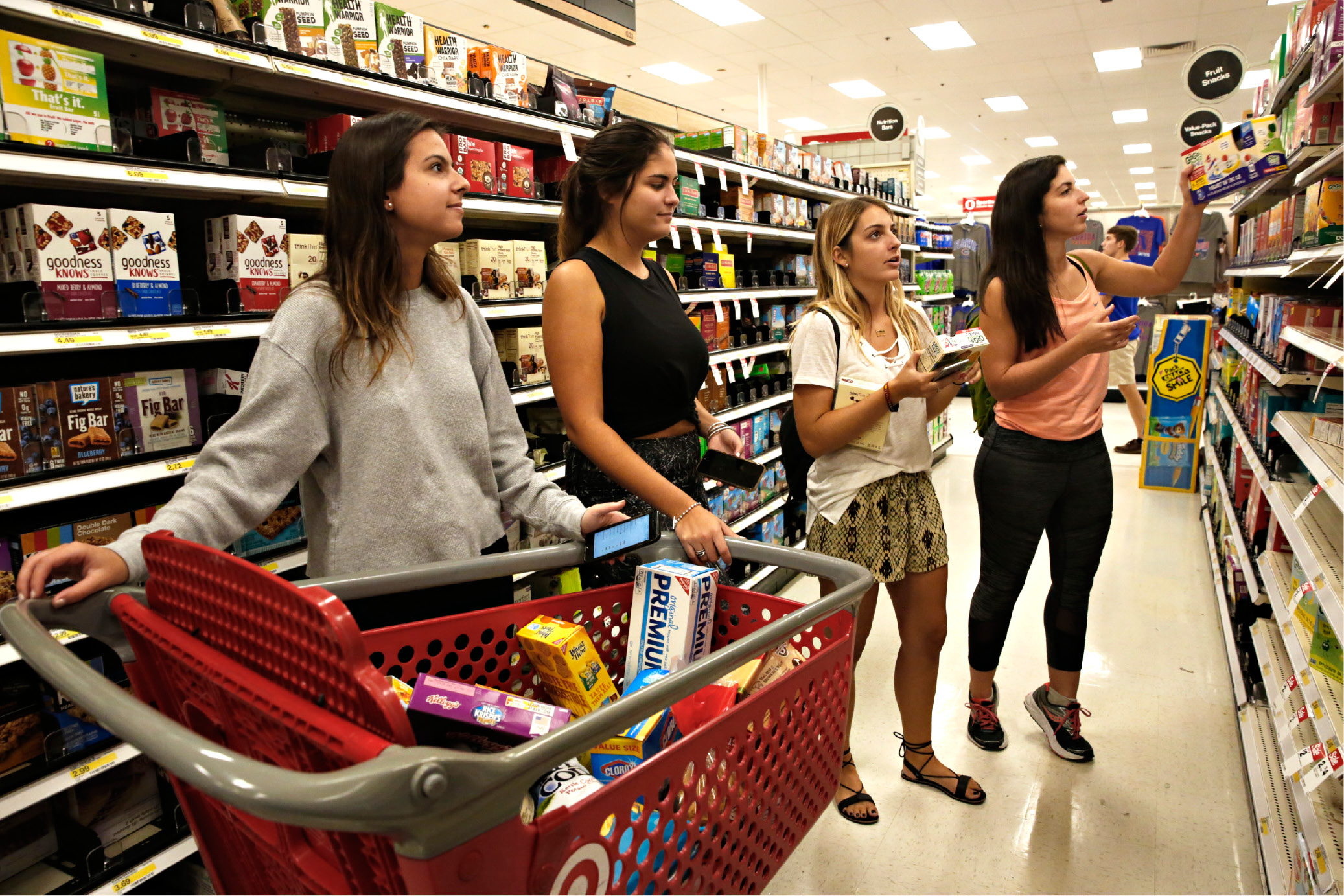 From left, Denise Cabrera, Veronica Vicente, Alejandra Sanchez and Carolina Rodriguez,  prep for hurricane Irma and shop for non-perishable food  in Gainesville, Fla., Sept. 5, 2017.  Irma roared into the Caribbean with record force early Wednesday, its 185-mph winds shaking homes and flooding buildings on a chain of small islands along a path toward Puerto Rico, Cuba and Hispaniola and a possible direct hit on densely populated South Florida.   (Andrea Cornejo/The Gainesville Sun via AP)