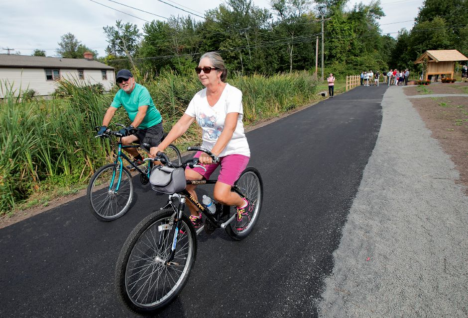 George and Cheryl Gibran, of Wolcott, are one of the first to bike on a new section of the Southington linear trail after a ribbon cutting ceremony near Lazy Lane in Southington, Thursday, Sept. 21, 2017. | Dave Zajac, Record-Journal