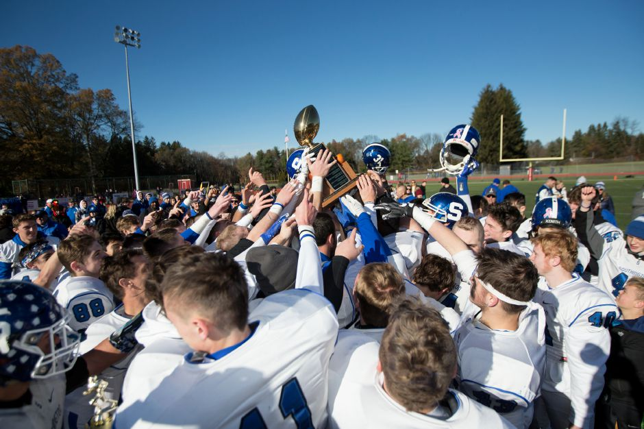 Southington celebrates with the Apple Classic trophy Thursday during the 22nd Annual Apple Classic on Thanksgiving Day at Alumni Field on the campus of Cheshire High School in Cheshire. The Blue Knights of Southington defeated the Cheshire Rams 30 to 22. November 23, 2017 | Justin Weekes / For the Record-Journal