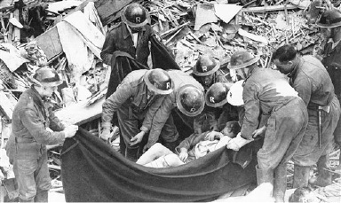 Rescue workers remove a victim from the ruins of a bombed London Hospital, Oct. 21, 1940. The building was struck during a raid the on October 8-9. No identification of the victim was found. (AP Photo)
