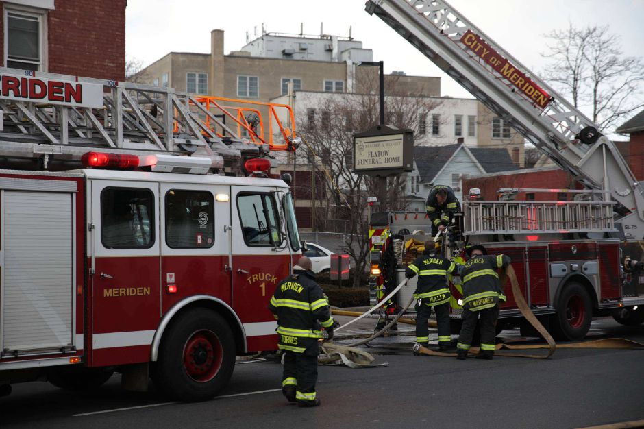 Firefighters responded to a blaze in a residential and commercial building on Hanover Street Tuesday afternoon. | Devin Leith-Yessian, Record-Journal