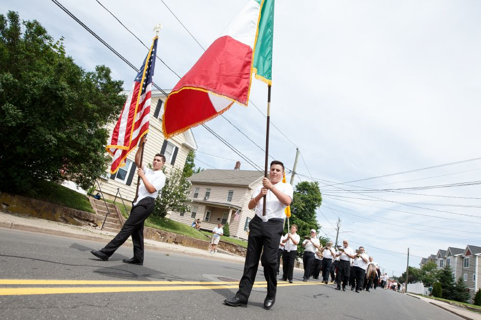 Mario Izzo 14 left and twin brother Luca lead the procession Sunday during an outdoor mass in celebration of the Italian Festival in Southington July 29, 2018 | Justin Weekes / Special to the Record-Journal