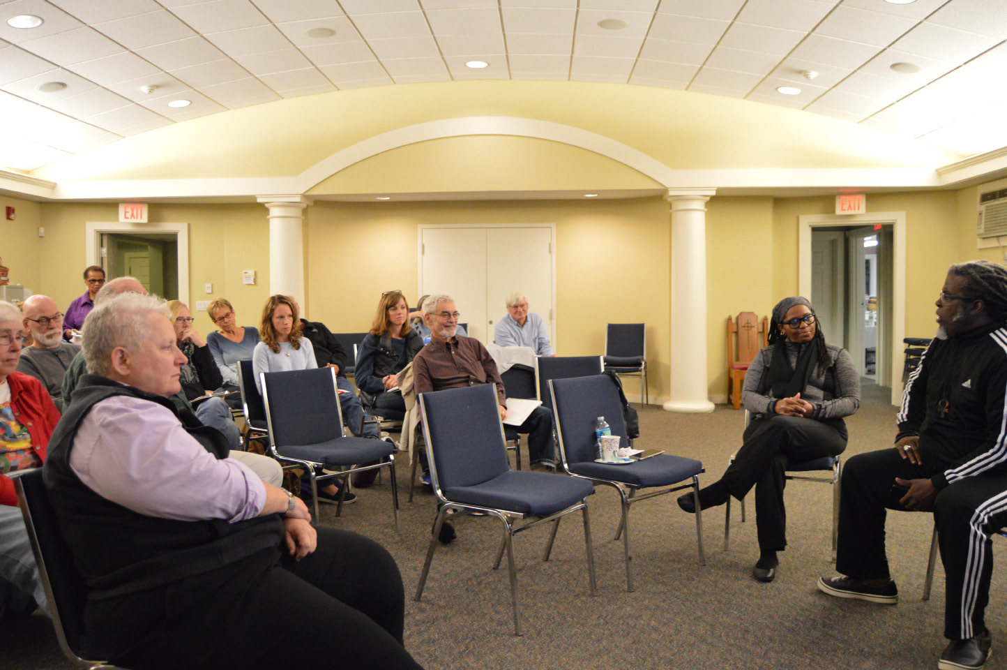 "Members of the Unitarian Universalist Church in Meriden listen Friday as Bishop John Selders discusses the ""theological underpinnings of the Black Lives Matter movement"" during the first in a series of three conversations at their church. 