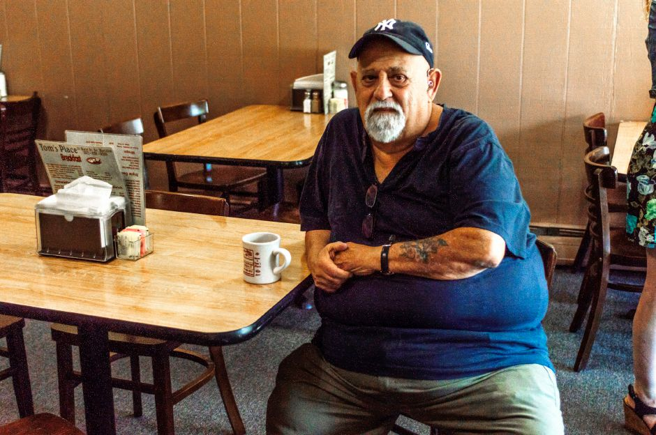 Tom Caliendo, of Meriden, sits at a table in his South Meriden diner, Tom