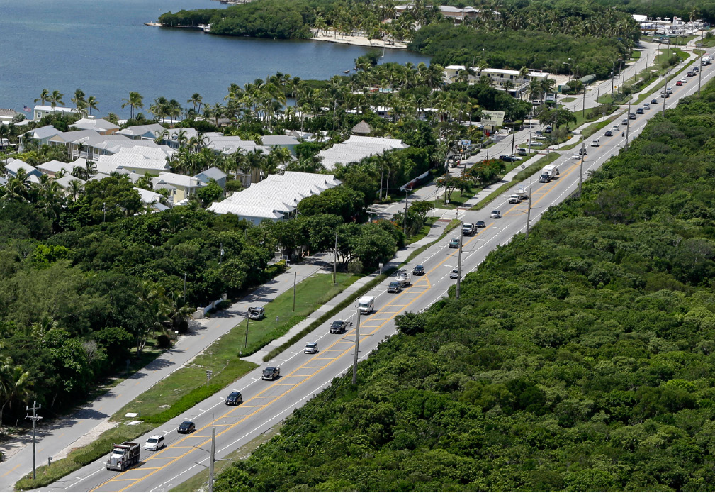 Motorists head north of Tavernier, Fla., Wednesday, Sept. 6, 2017. Keys officials announced a mandatory evacuation Wednesday for visitors, with residents being told to leave the next day. (AP Photo/Alan Diaz)