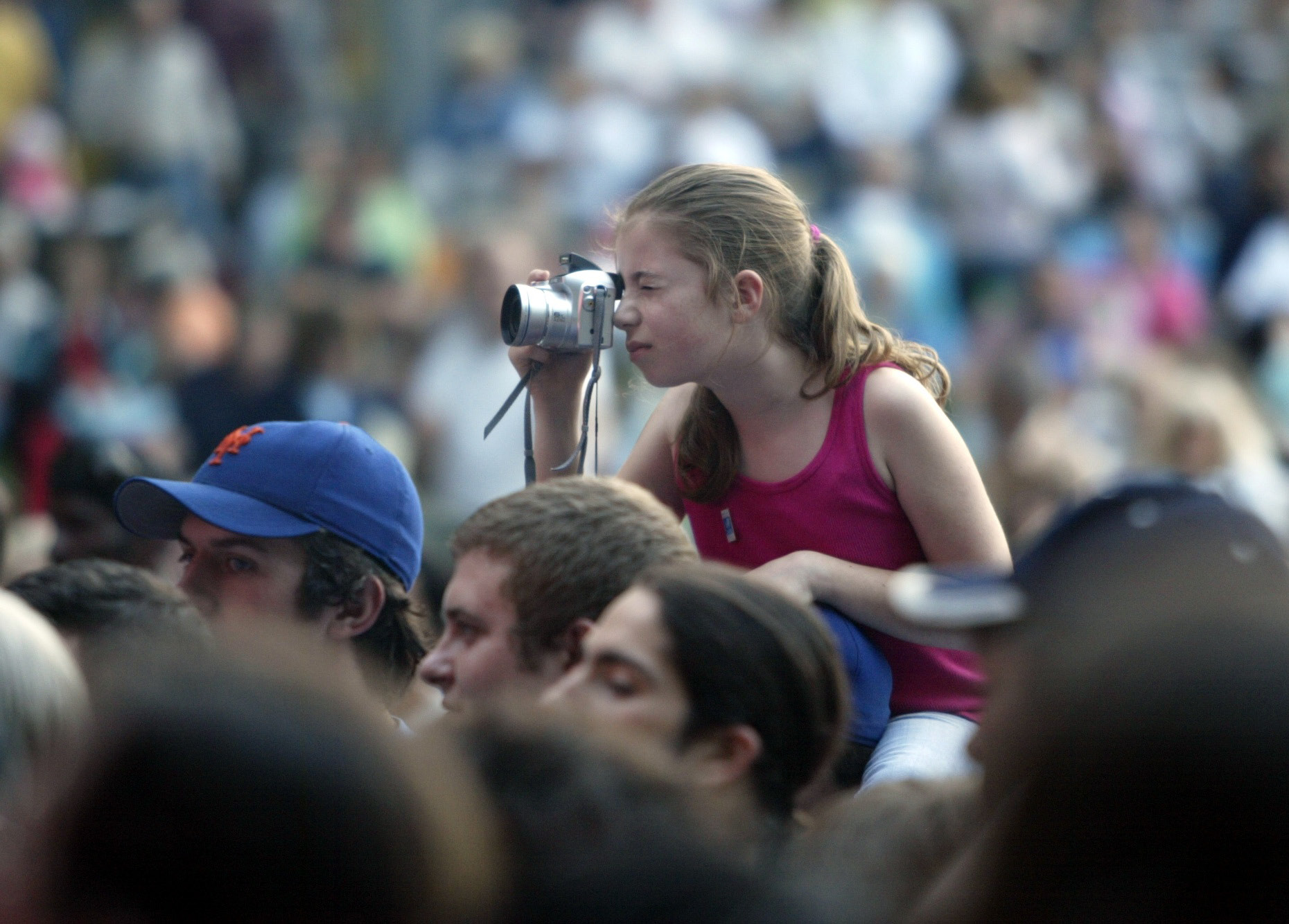 Jessica Deegan, then 10, sits on the shoulders of her father, Mike Deegan, to get above the crowd for a better picture of Chuck Berry as he performs at Hubbard Park on in June 2006.| File photo, Record-Journal